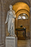 Voltaire's statue and tomb in the crypt